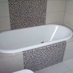 New bath fitted, with designed tiling