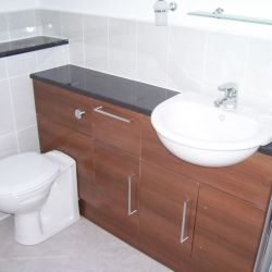 New sink and toilet fitted, with bathroom cabinets
